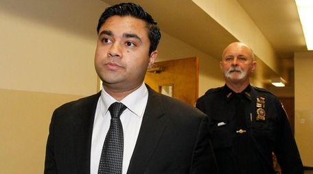 Raj Jadeja, seen leaving court in Mineola on
