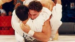 Royce Gracie, bottom, submitted Ken Shamrock in the