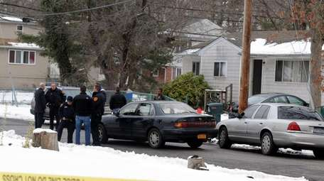 Police at the scene where a Suffolk County