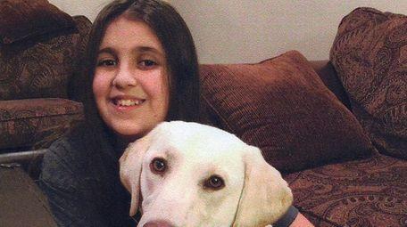 Kidsday reporter Amanda Perillo with her service dog,