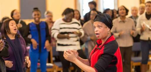 Darcel Whitten-Wilamowski leads members of the Sister Thea