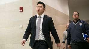 NYPD Officer Peter Liang leaves the courtroom in