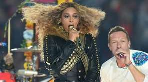 Beyonce and Chris Martin perform during Super