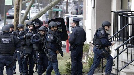 New York City police enter a hotel, Wednesday,