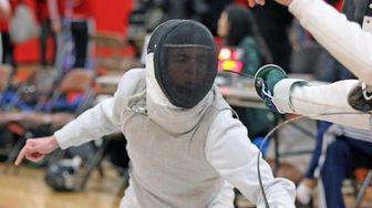 Ward Melville's Stephen Jackson wins his foil match