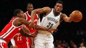 Thaddeus Young of the Brooklyn Nets draws a