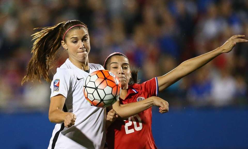 Alex Morgan of USA scores a goal in