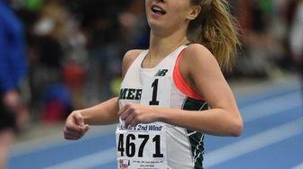 Mercy's Meg Tuthill wins the girls 1,000-meter run