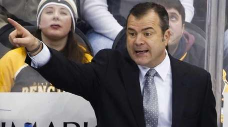 New York Rangers' Alain Vigneault gives instructions during