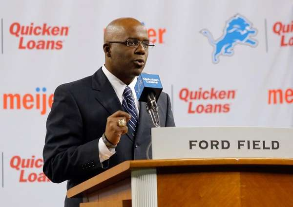 Then-Detroit Lions general manager Martin Mayhew introduces Jim