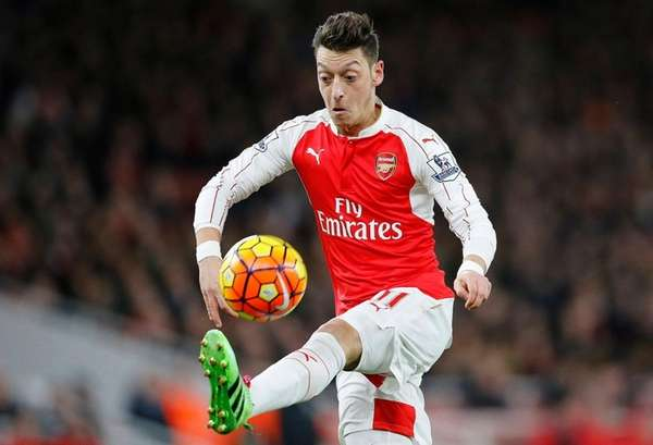 Arsenal's Mesut Ozil stops the ball during