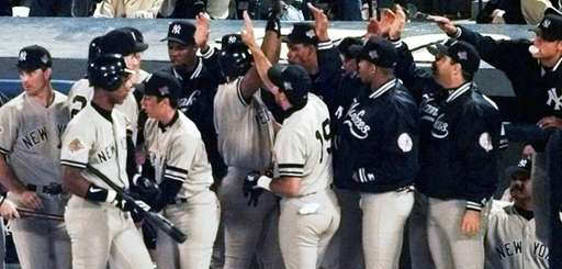 The New York Yankees celebrate Bernie Williams' two-run