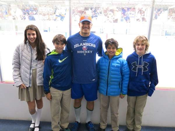 Islanders star Kyle Okposo with Kidsday reporters from