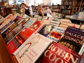 Books are seen on display as people shop