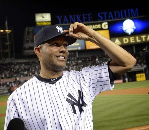 New York Yankees pitcher Mariano Rivera tips his
