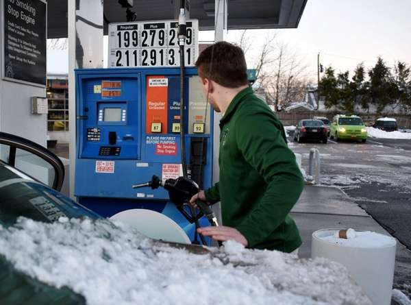 A customer gasses up at an East Norwich