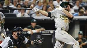 Oakland Athletics first baseman Ike Davis follows
