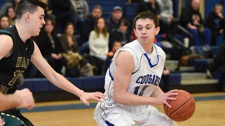 Centereach's Kevin Callahan controls the ball against Ward