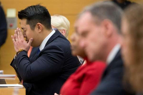 NYPD Officer Peter Liang puts his face in
