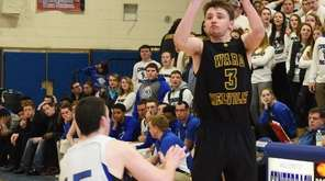 Ward Melville's Matt Hudzik shoots a three-point shot