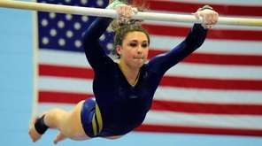 Massapequa's Heidi Baldinger competes on the uneven bars