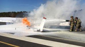 Emergency crews respond to a plane on fire