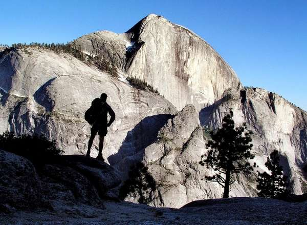 A backpacker views Half Dome, the 8,842-foot symbol