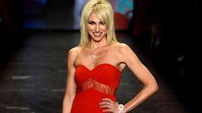 Singer Debbie Gibson walks the runway at The