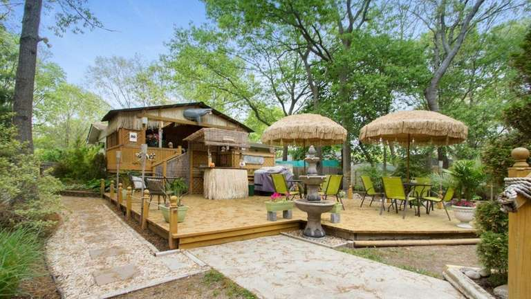 A tiki bar, though currently under snow, promises