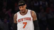 New York Knicks forward Carmelo Anthony reacts in