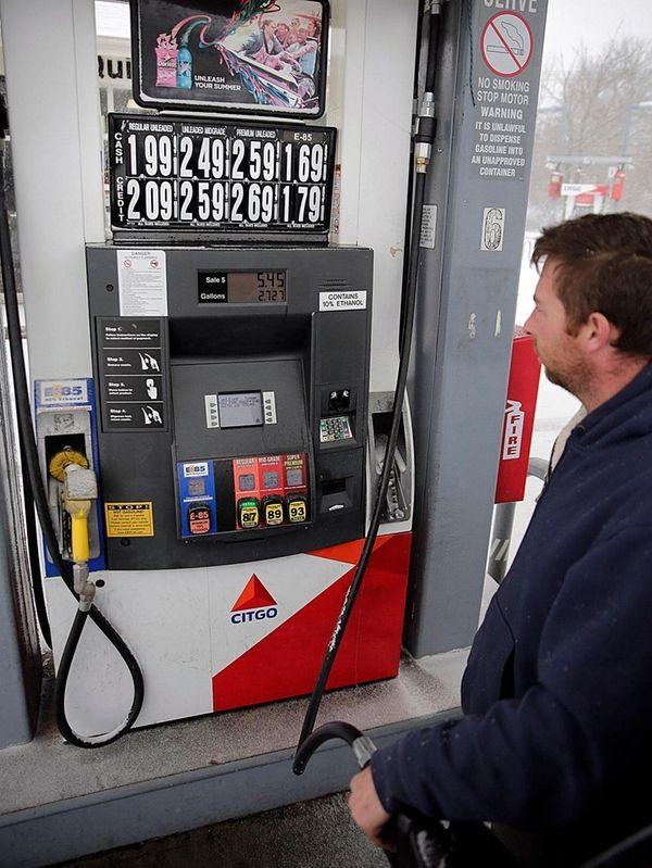 A man fills his car with regular at