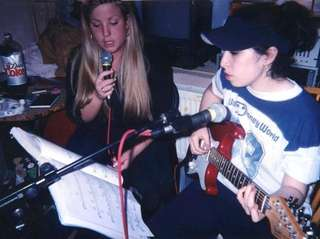 A young Amy Winehouse, right, in a scene