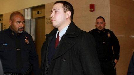 Officer Shaun Landau leaves the courtroom during Officer