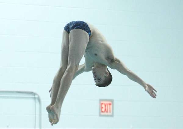 Patrick Carter of West Islip dives off the