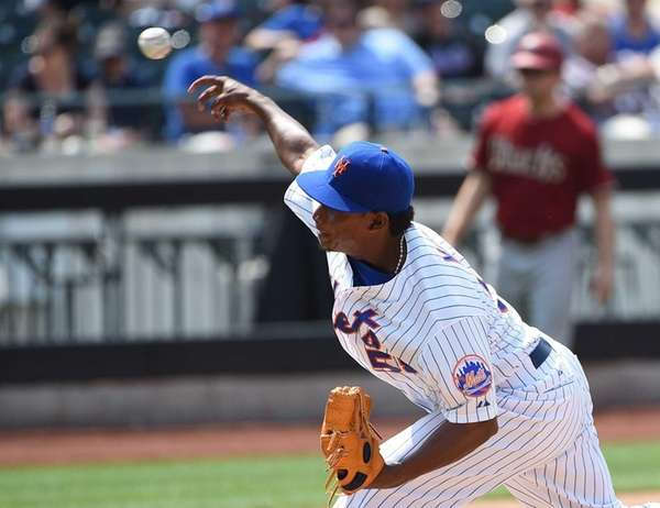 New York Mets relief pitcher Jenrry Mejia delivers