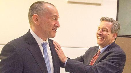 Nassau Interim Finance Authority chairman Jon Kaiman, right,