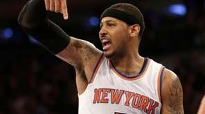 Carmelo Anthony reacts to a referee's call during