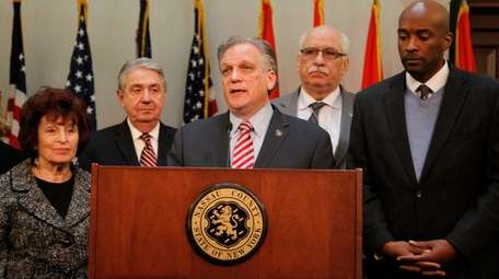 Nassau County Executive Edward Mangano leads a news