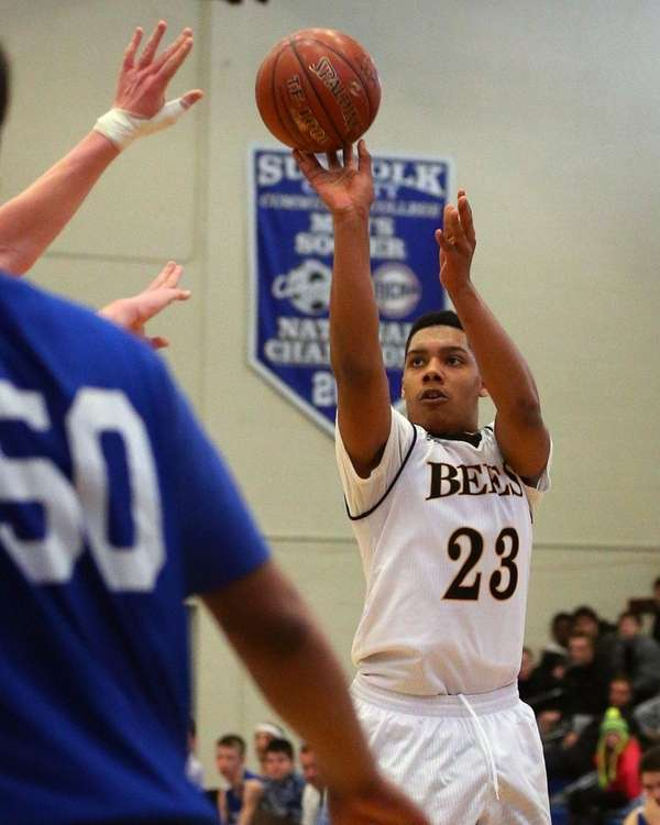 Bridgehampton's Elijah Jackson #23 sinks a three pointer