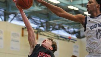 Pierson's Sean Sloane has his shot blocked by