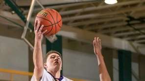 Oyster Bay's Robert Howes shoots over Malverne's Foley