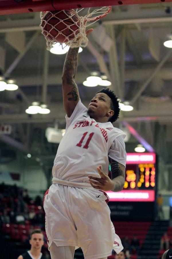 Rayshaun McGrew dunks the ball during Stony Brook's