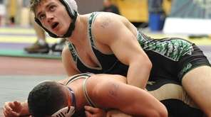 Alex Pavlock of Farmingdale, top, battles Nick Coppola