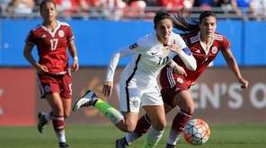 Carli Lloyd of USA scrambles for the ball