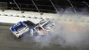 Kevin Harvick, left, wrecks with Brian Vickers (14)