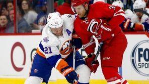 New York Islanders' Kyle Okposo (21) battles with