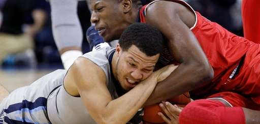 Villanova's Jalen Brunson, bottom, and St. John's