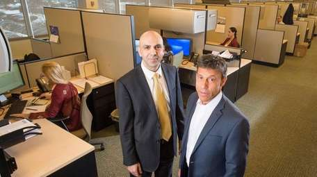 Employee relations vice president Andrew Sirlin, right, and