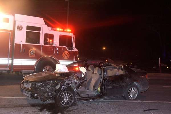 A car sits wrecked after a wrong-way collision