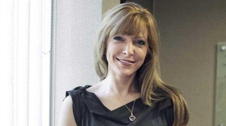 Karin Caro of BluChip Marketing poses for a